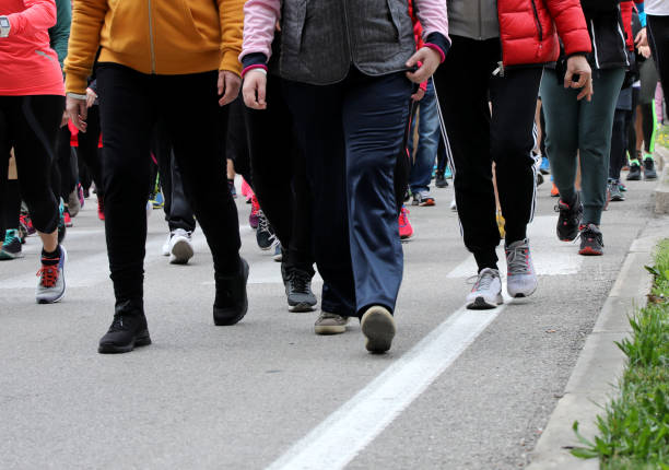 people walk down the street during a demonstration in the city stock photo