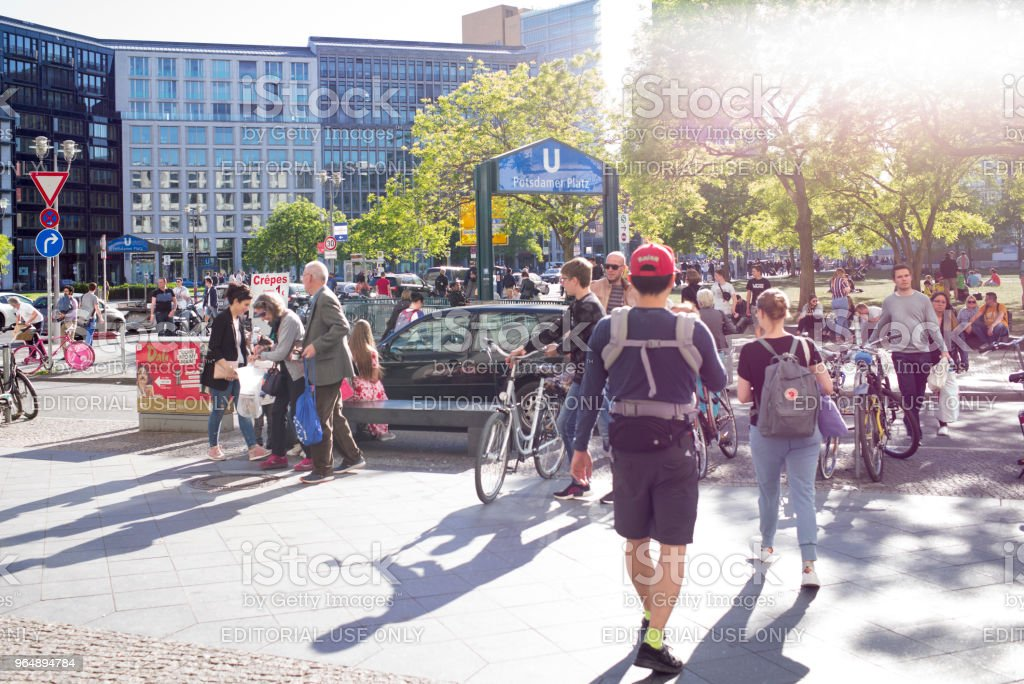 People walk in front of a subway entrance at Potsdamer Place. royalty-free stock photo