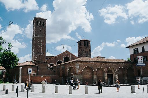 MILAN, ITALY - JULY 17, 2016: People walk in front of Saint Ambrogio basilica.