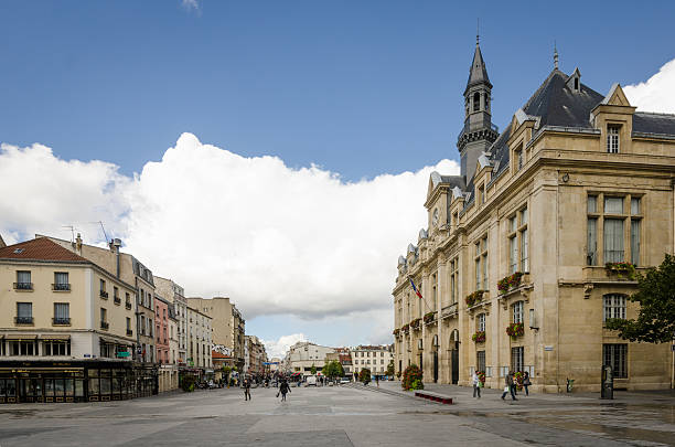 People walk in front of the Saint-Denis city hall stock photo