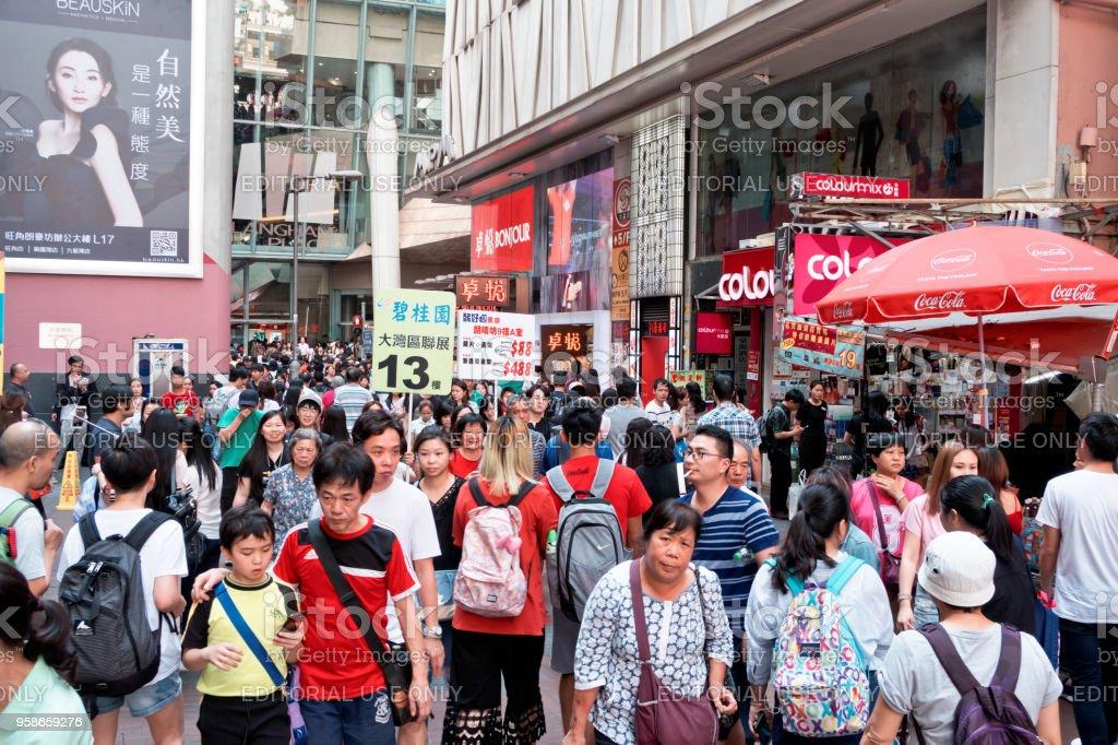 People walk in Mongkok district stock photo