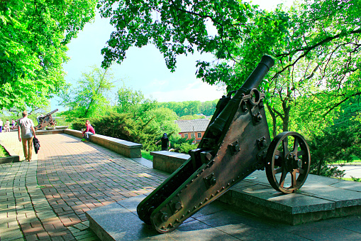 people walk in the city park with old cannons in Chernihiv