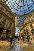 Milan, Italy - Apr 17, 2019: People walk inside of the Galleria Vittorio Emanuele II in Milan, Italy