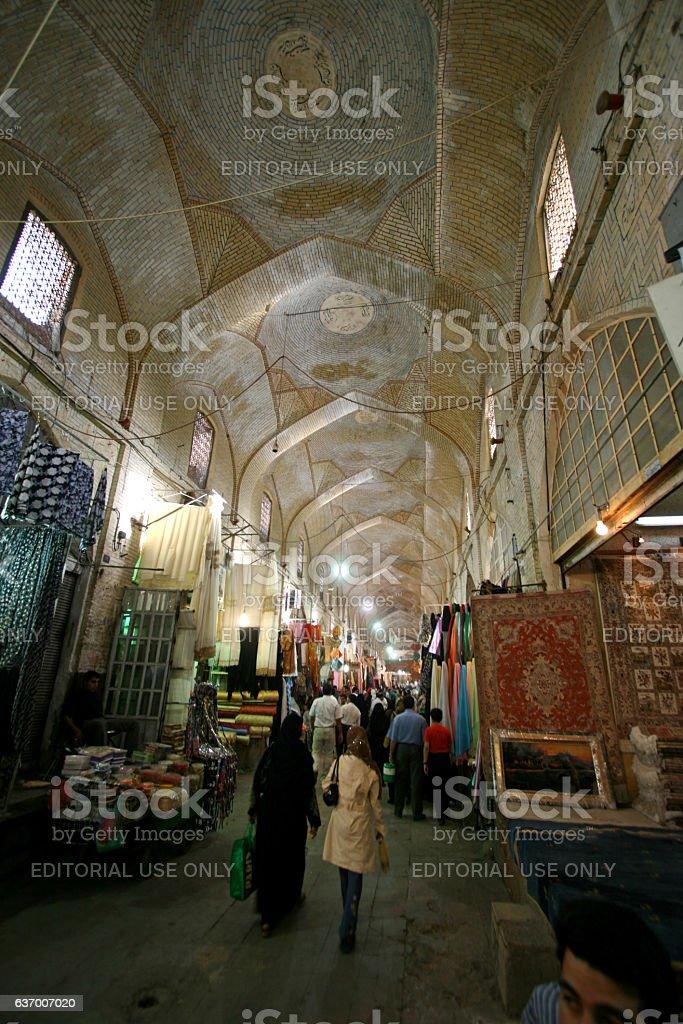 People walk inside the old Bazaar-e Vakil stock photo