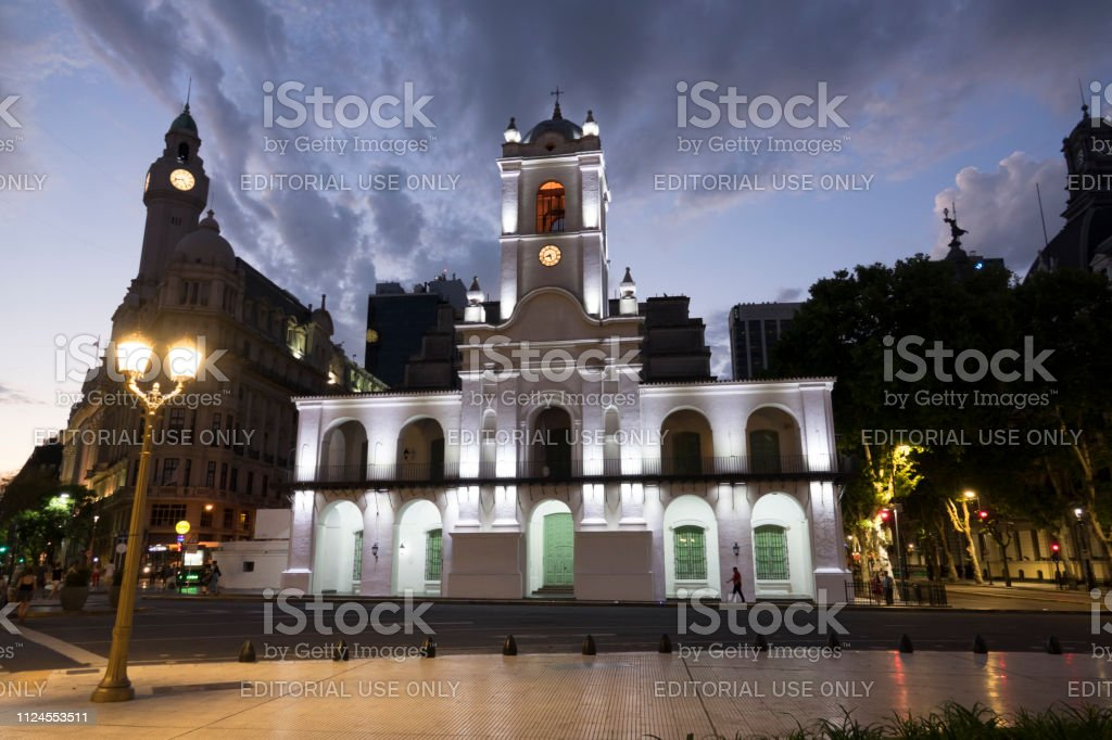 People walk nighttime streets Plaza de Mayo park Cabildo Buenos Aires Argentina stock photo