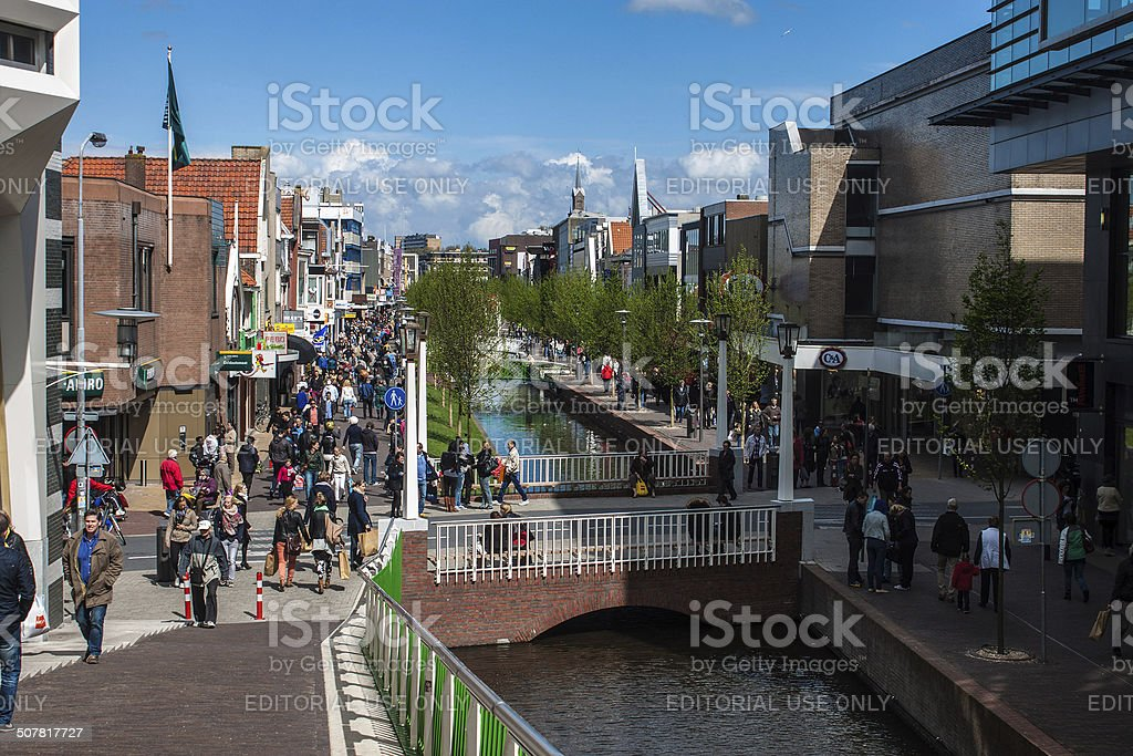 People walk on a pedestrian zone in Zaandam stock photo