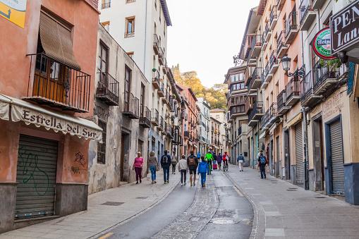Granada, Spain - November 2, 2017: People walk on a street in the center of Granada.