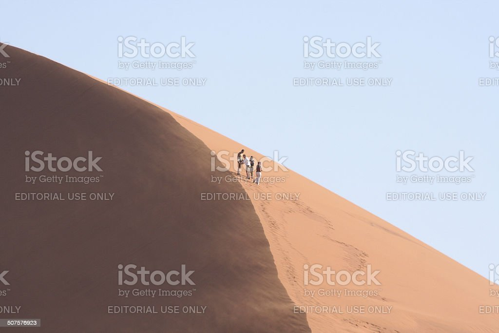 People walk on Dune 45,Sossusvlei, Namib Desert, Namibia, Africa stock photo