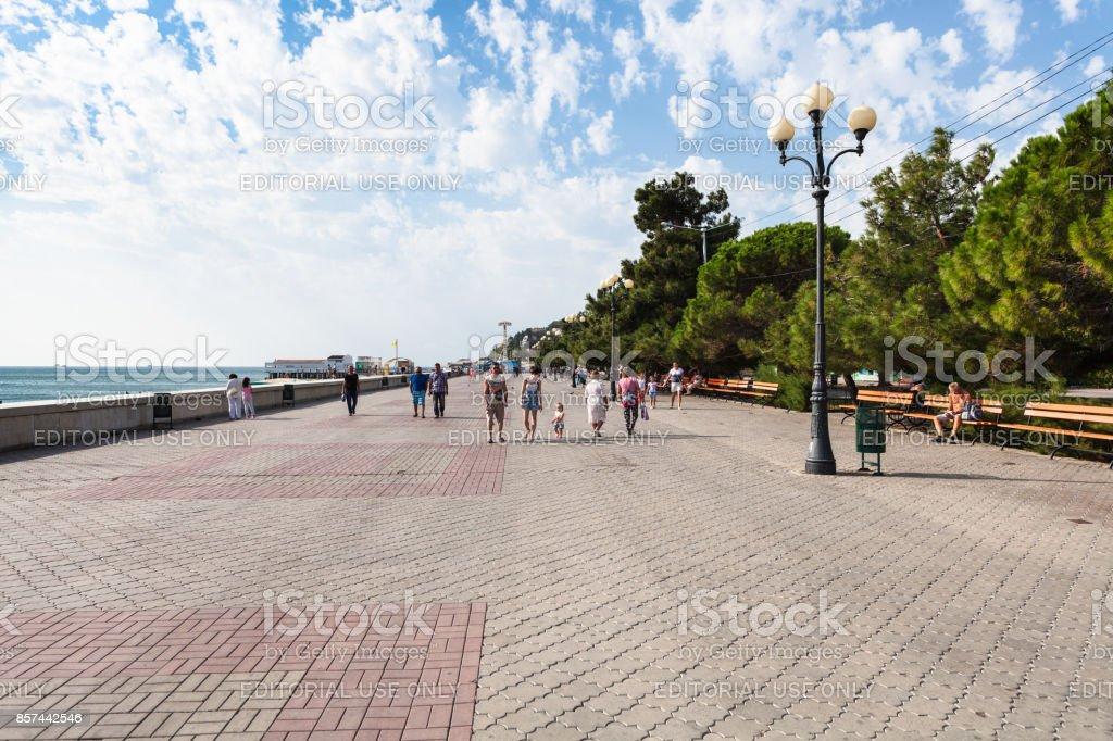 people walk on Embankment in Alushta in september stock photo