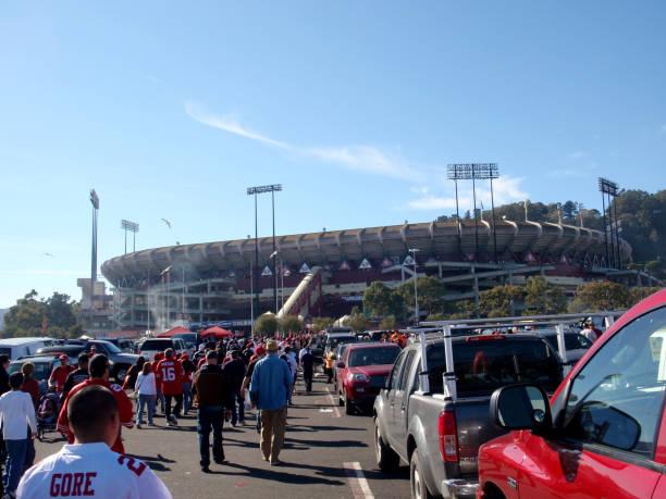 People walk through Candlestick Parking lot to the stadium stock photo