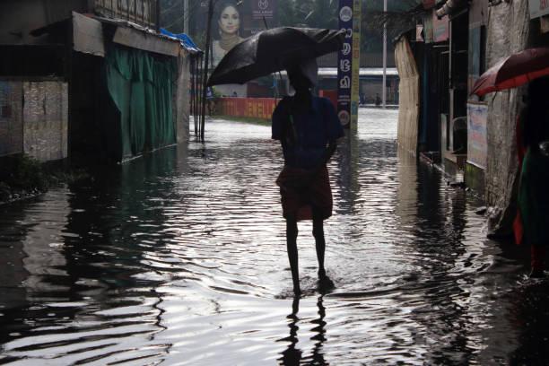 People walk through flood water stock photo