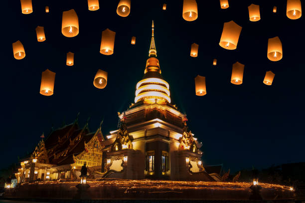 People walk with lighted candles to respect Buddha at thailand stock photo