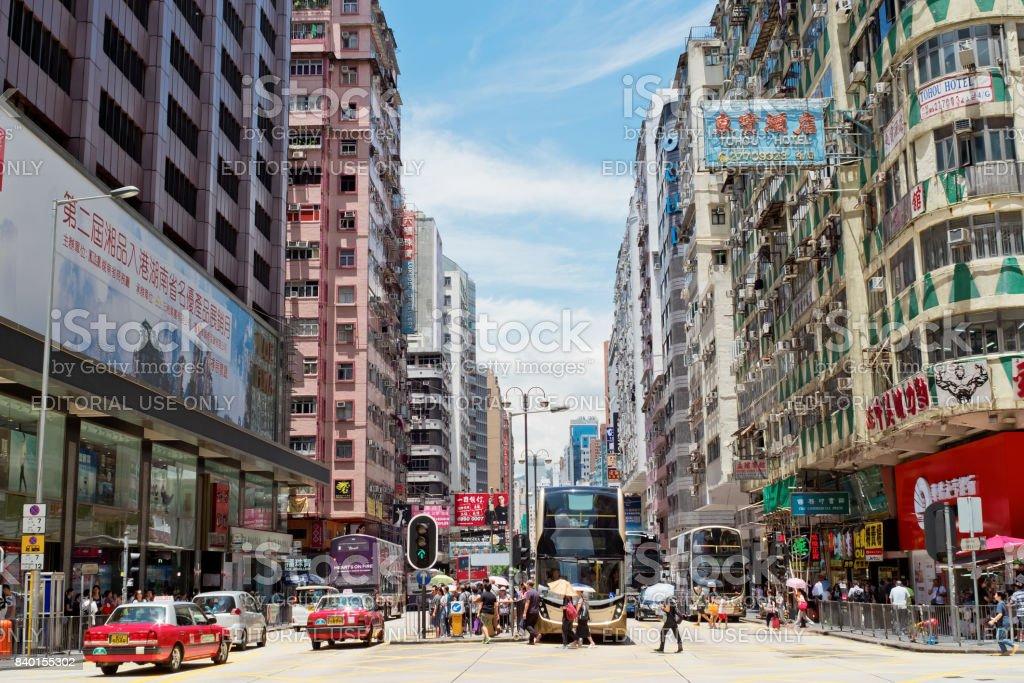 People walking across Nathan Road Kowloon, Hong Kong. stock photo