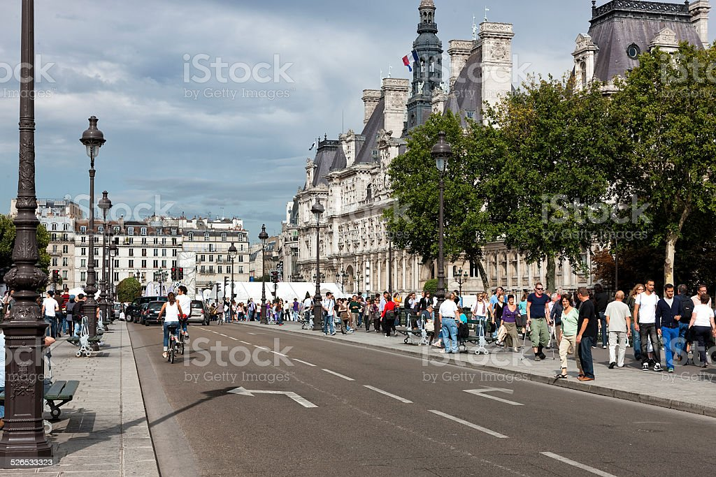 People Walking Across the Bridge Pont d'Arcole, Paris, France stock photo