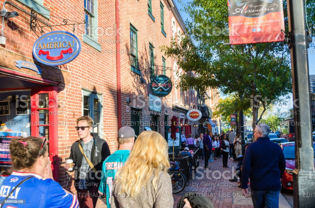 People walking along King Street in Old Town Alexandria, VA, on a Sunny Autumn Day stock photo