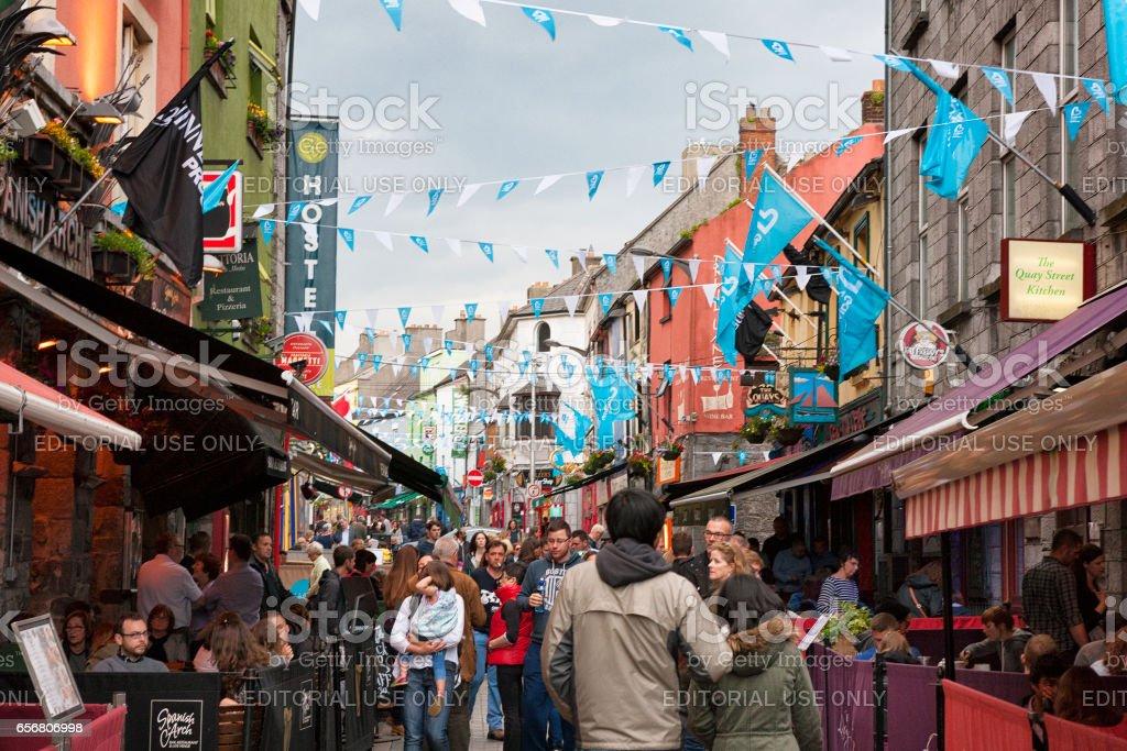 People walking along Shop Street in Galway, Ireland stock photo