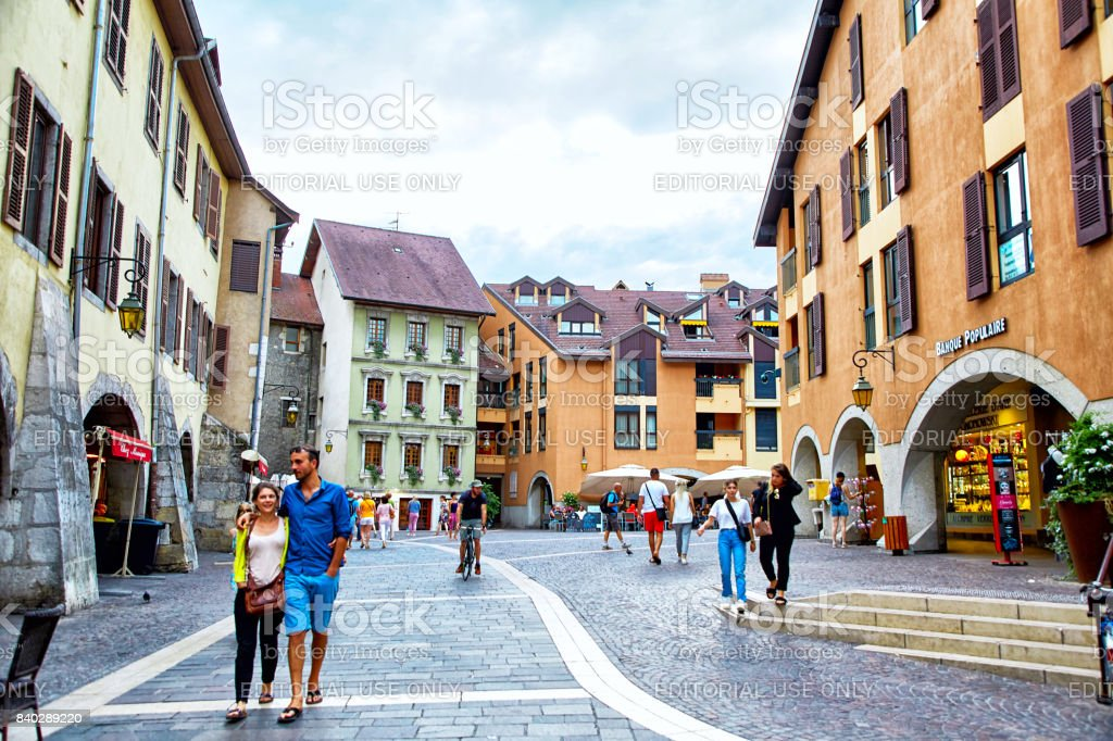 People walking, and eating around Old Town Annecy stock photo