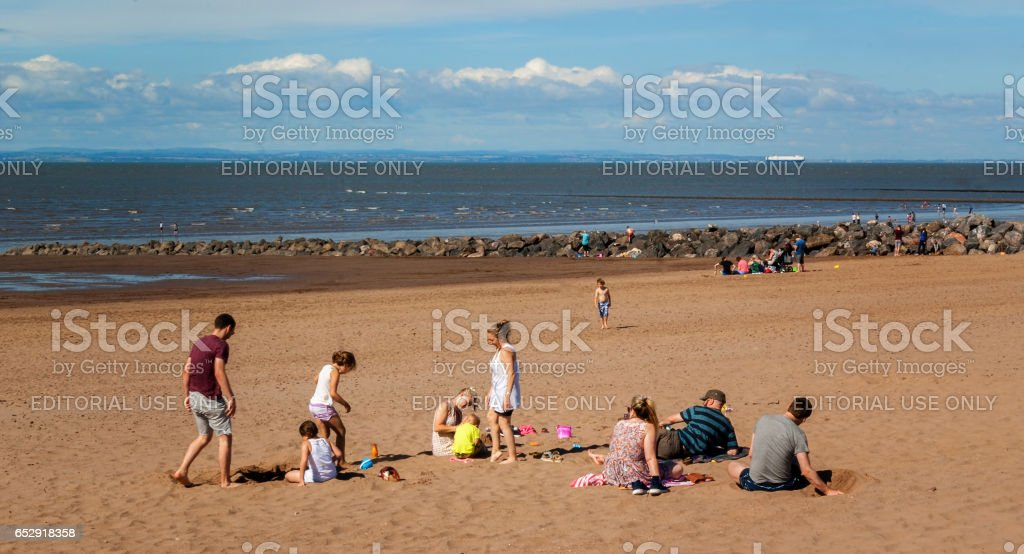 Minehead, UK - July 27, 2016: People walking and enjoying a summer day in a shoreside in Minehead, UK. stock photo