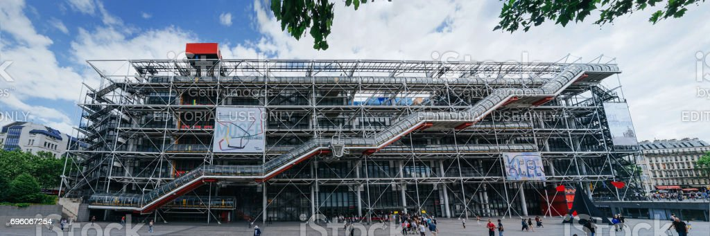 PARIS, FRANCE - JUNE 25, 2016: People walking and resting in front of Centre of Georges Pompidou in Paris, France. It is one of the most famous museums of modern art in the world. stock photo