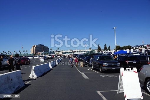 Santa Clara, United States - March 29, 2015: People walking and tailgate in parking lot before the start of the showcase of the immortals, Wrestlemania 31, at the Levi's Stadium in Santa Clara, California on March 29, 2015.