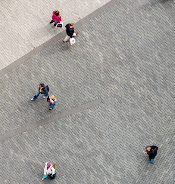 People walking at a distance stock photo
