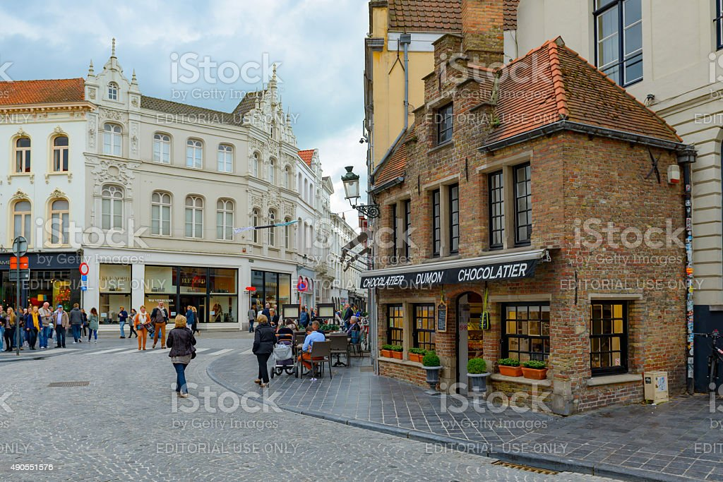 People walking at a shopping street of Bruges stock photo