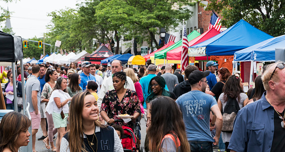 Bay Shore, NY, USA - 10 June 2018: The Hamlet of Bay shore on Long Island streets are crowded with vendors and people during their annual community street fair.