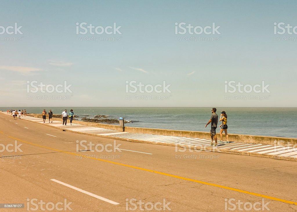 People Walking at the Boardwalk stock photo
