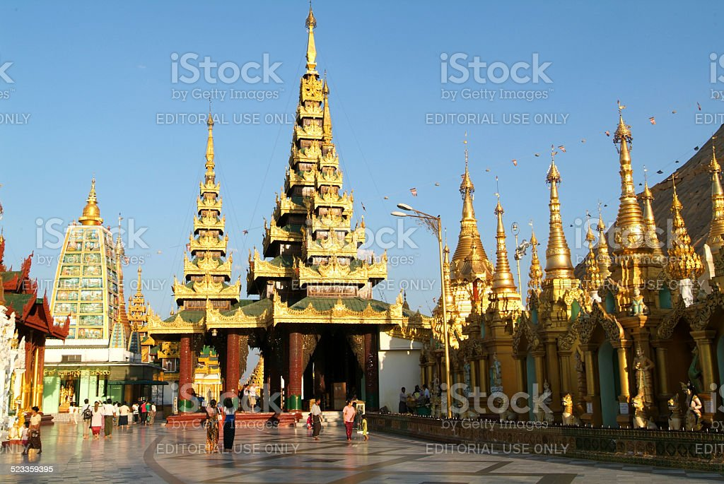 People walking at the Shwedagon Pagoda in Yangon stock photo