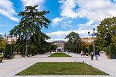 People walking by Buen Retiro Park in Madrid