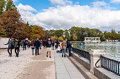 People walking by Pond in Retiro Park in Madrid