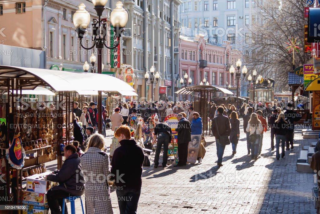 People walking down the famous Arbat street in the historical center of Moscow. stock photo