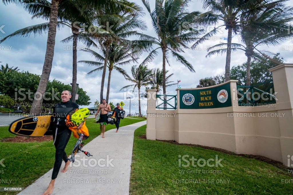 People walking from the beach before rain, Boca Raton, USA stock photo