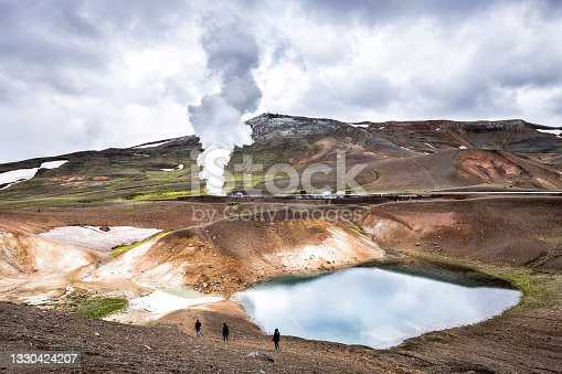 istock People walking hiking on Viti Crater of Krafla caldera geothermal formation with small lake water and mountains snow during summer and geyser hot spring steam 1330424207