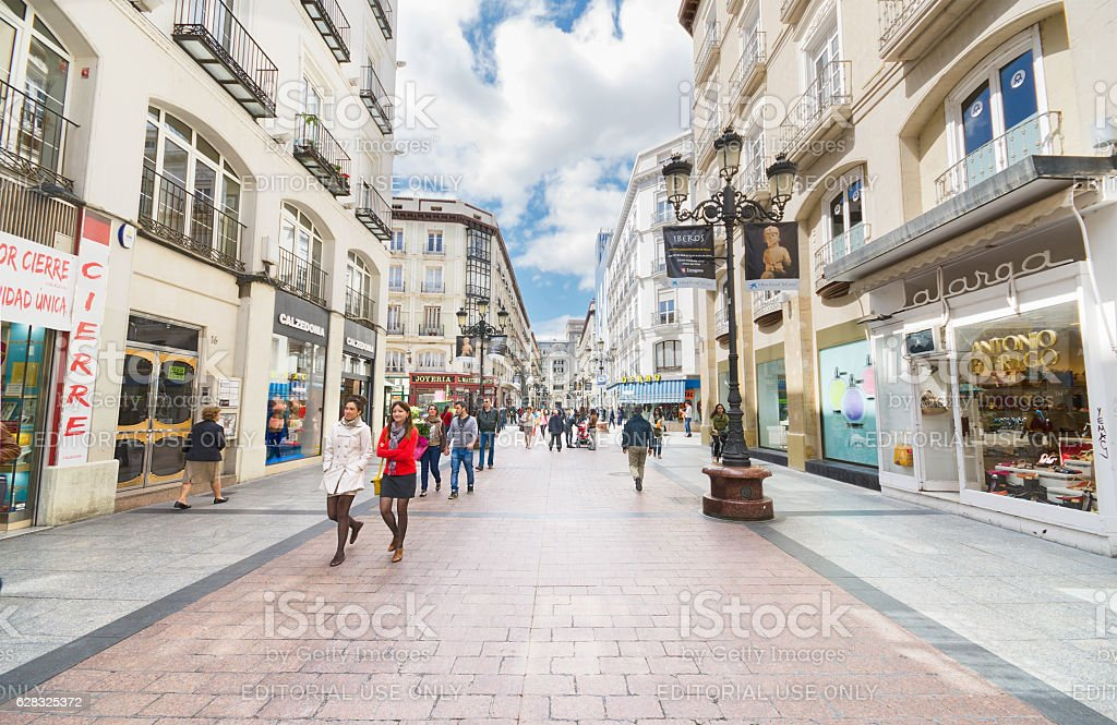 people walking in a famous commercial street in Zaragoza. stock photo