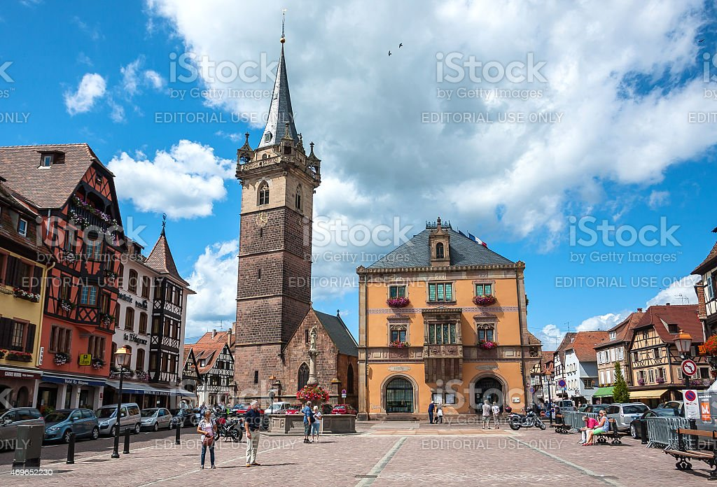 People walking in a Obernai town centre stock photo
