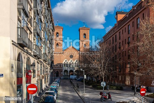 istock People walking in a street next to a church at Madrid city, Spain. 1259060978