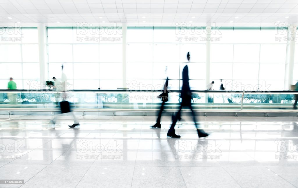 People walking in airport stock photo