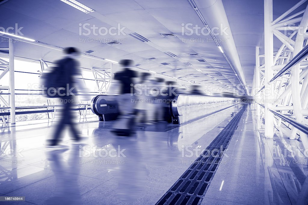 People Walking in Airport Tunnel royalty-free stock photo