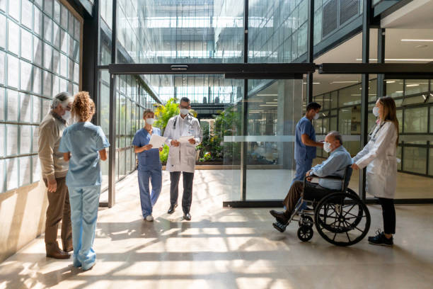 People walking in and out of the hospital stock photo