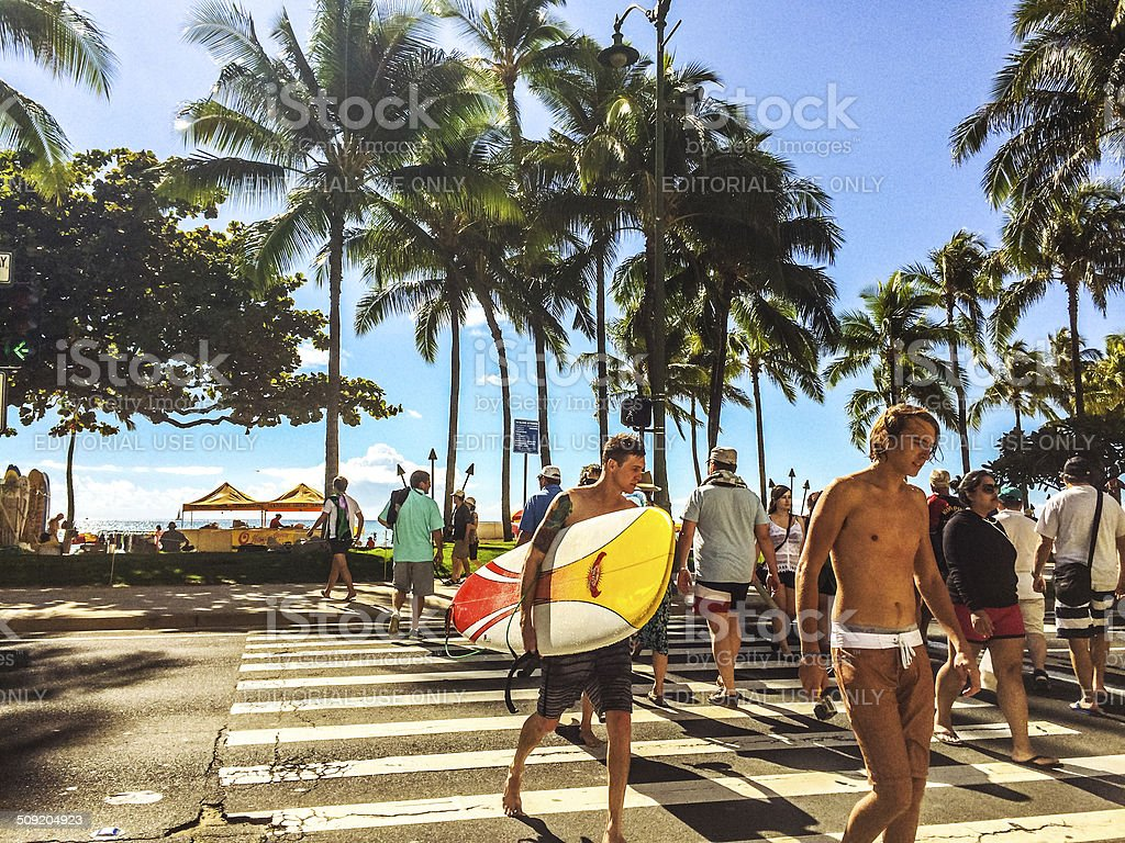 People walking in and out of Waikiki Beach, Honolulu, USA stock photo