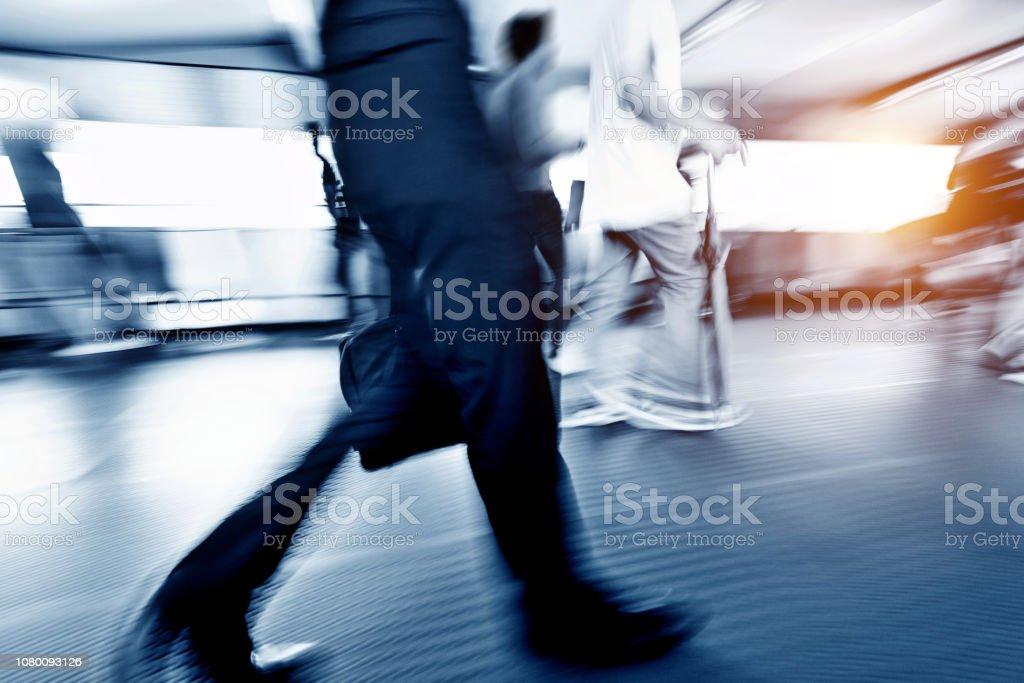 People walking in corridor at rush hour stock photo