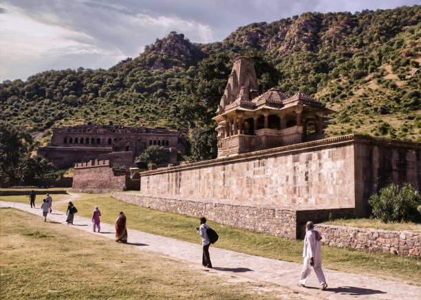 people walking in distance around abandoned cursed ruined fort - cursed stock pictures, royalty-free photos & images