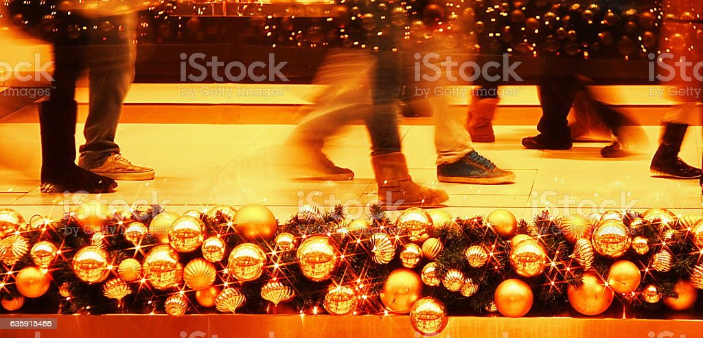 People walking in evening street illuminated and decorated for Christmas stock photo