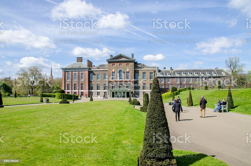 People walking in front of  Kensington Palace royalty-free stock photo