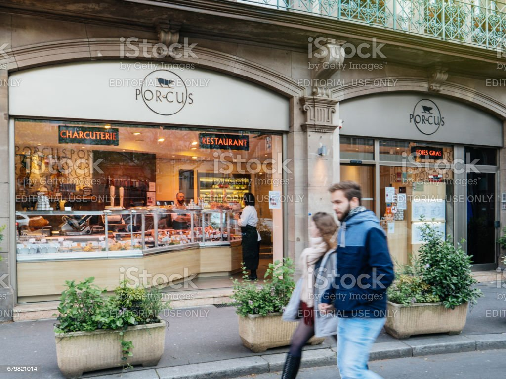 People walking in front of Meat restaurant stock photo