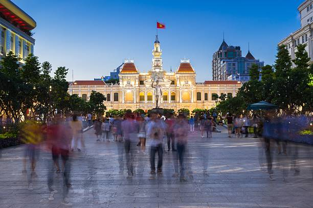 People walking in front of the People's Committee Building building, Vietnam stock photo