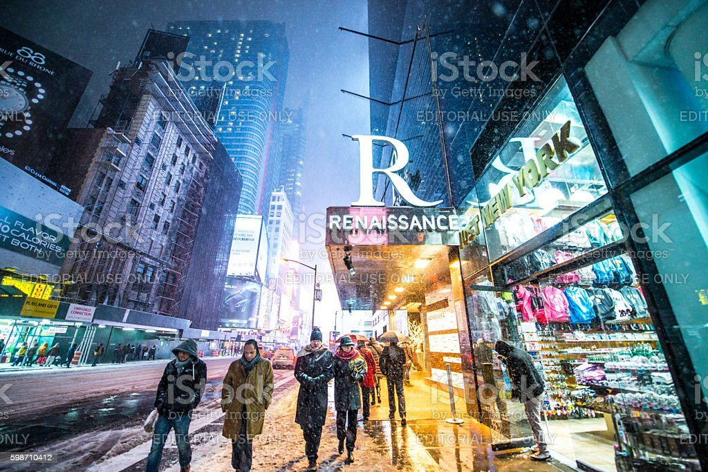 People walking in heavy snowstorm,  New York stock photo