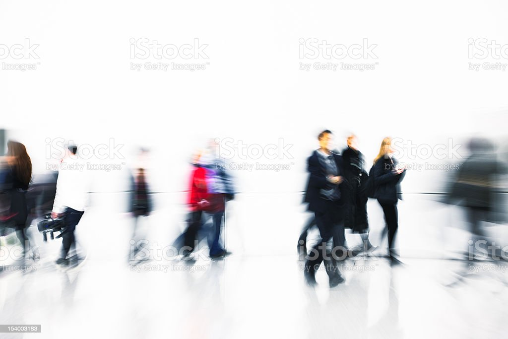 People Walking in Modern White Interior, Blurred Motion royalty-free stock photo