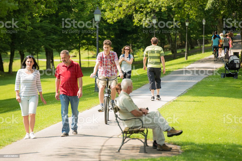 People walking in park stock photo